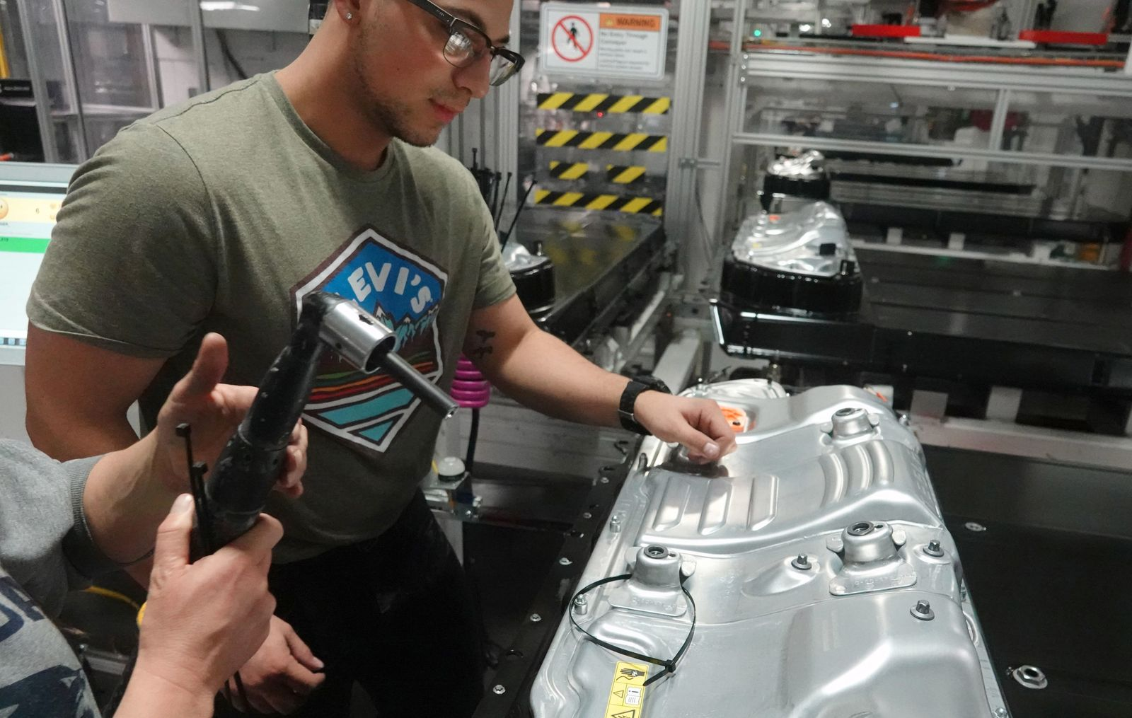 Tesla Workers Make Battery