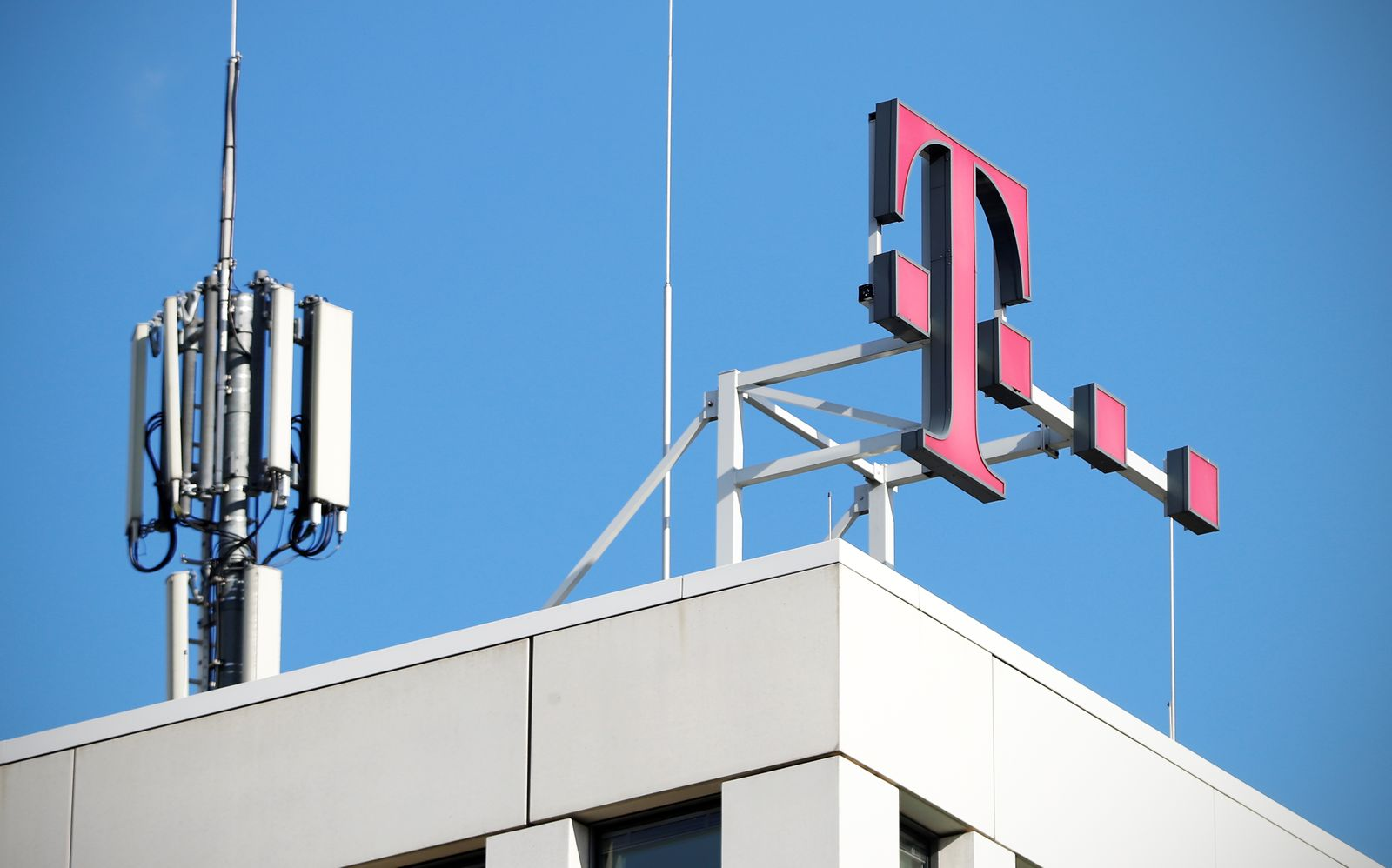 GSM mobile phone antennas and the logo of Deutsche Telekom AG are seen atop of the headquarters of German telecommunications giant in Bonn