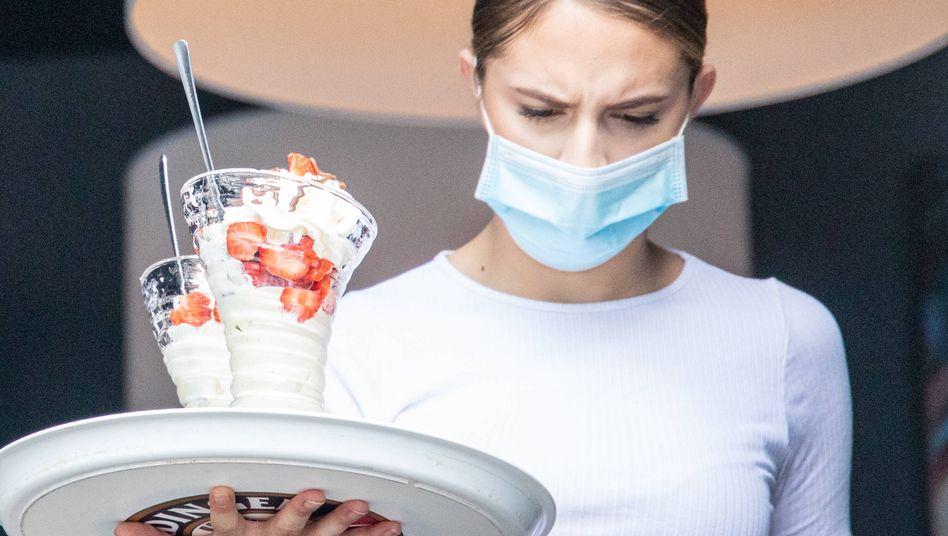 Maske tragen in körperlich anstrengenden Berufen: Sind mehr Pausen nötig?
