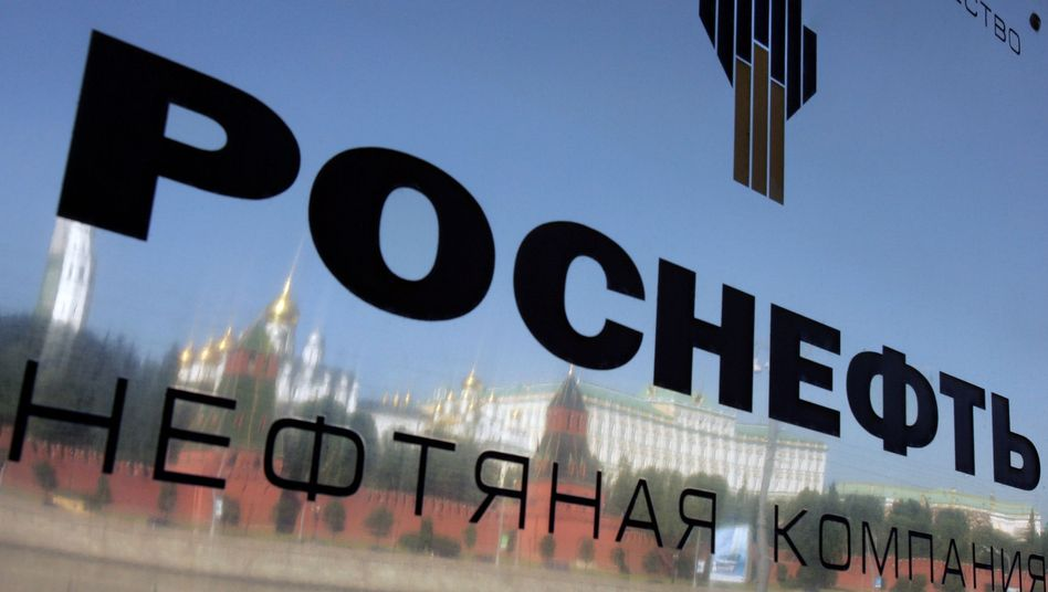 The Kremlin is reflected in a plaque at the entrance of the state-owned oil company Rosneft, located across the Moscow River.