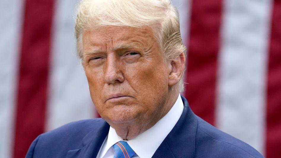 Donald Trump: Sein Widerstand gegen das Tragen einer Maske war Teil der Botschaft des starken Führers