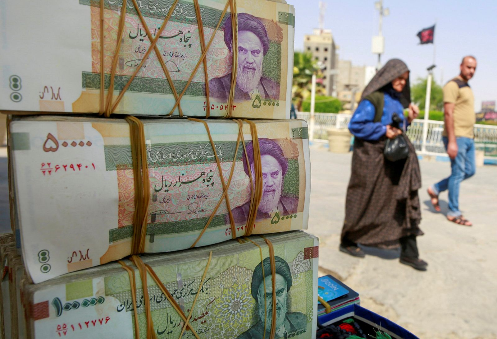 FILE PHOTO: Iranian rial currency notes are seen at a market in the holy Shi'ite city of Najaf
