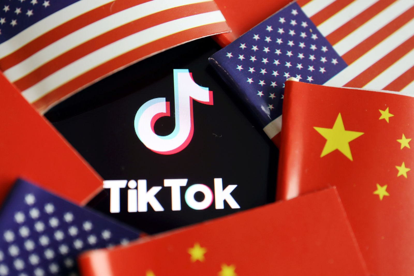 FILE PHOTO: Illustration picture of Tiktok with U.S. and Chinese flags