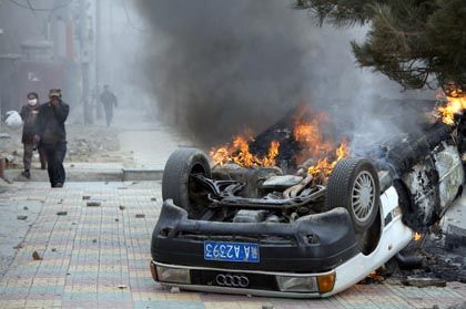 A car burns on a street in the Tibetan capital Lhasa Friday.
