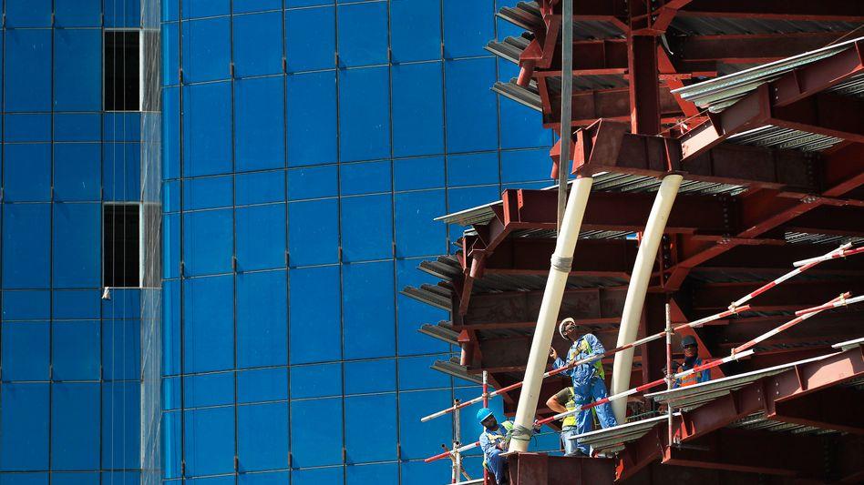 Arbeiter in Doha: Gebrochene Versprechen, verweigerter Lohn