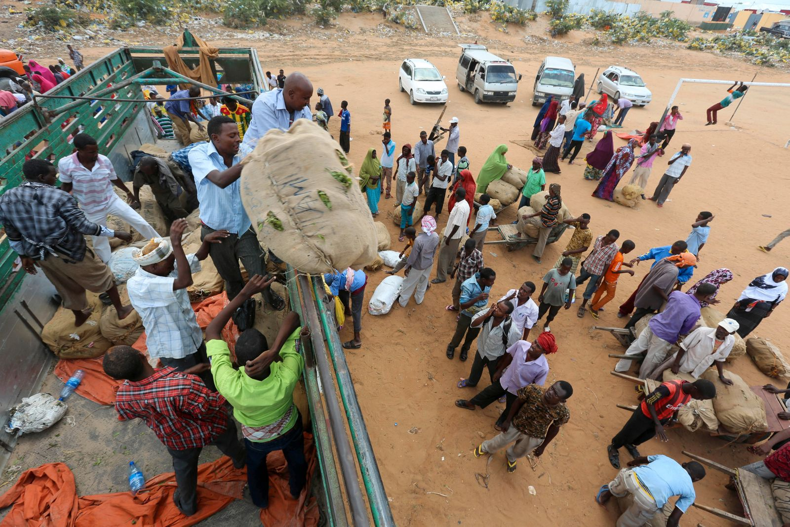 Porters gather around a truck carrying khat in Mogadishu