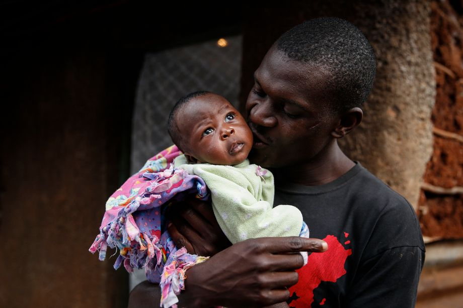 Shaniz Joy Juma, the baby from Kenya, about one month after her birth, with her father.