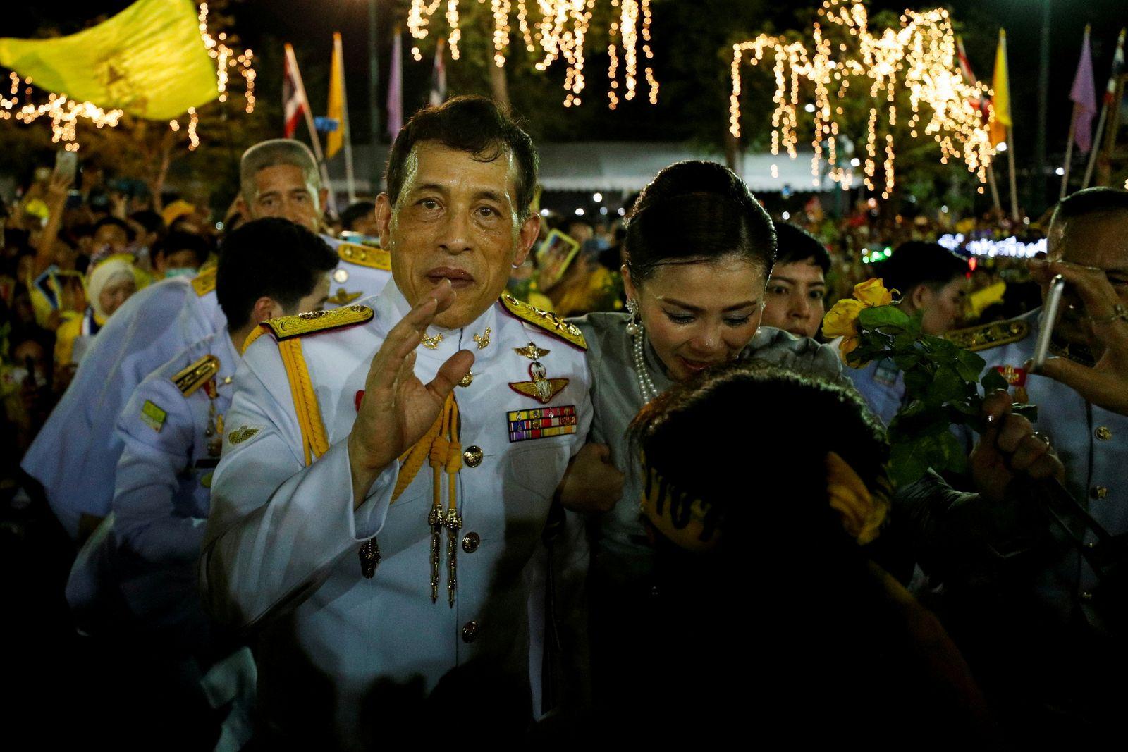 Thailand's King Maha Vajiralongkorn and Queen Suthida greet royalists, at The Grand Palace in Bangkok