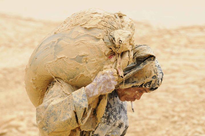 Förderung: Arbeiter einer Mine für Seltene Erden in der chinesischen Provinz Jiangxi