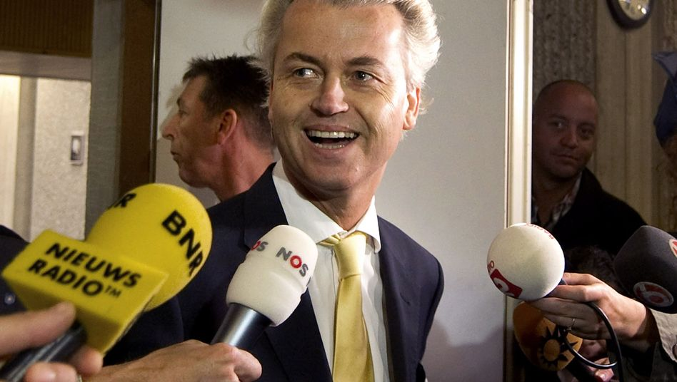 A happy Geert Wilders leaves the courtroom in Amsterdam after his acquittal.