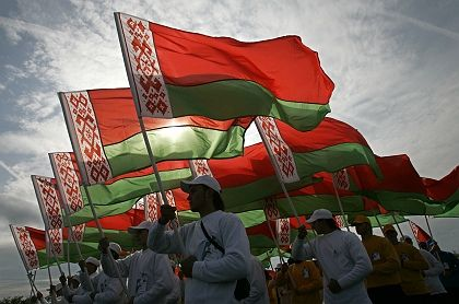 Belarusian sportsmen carry state flags during celebrations of a national festival marking the harvest.