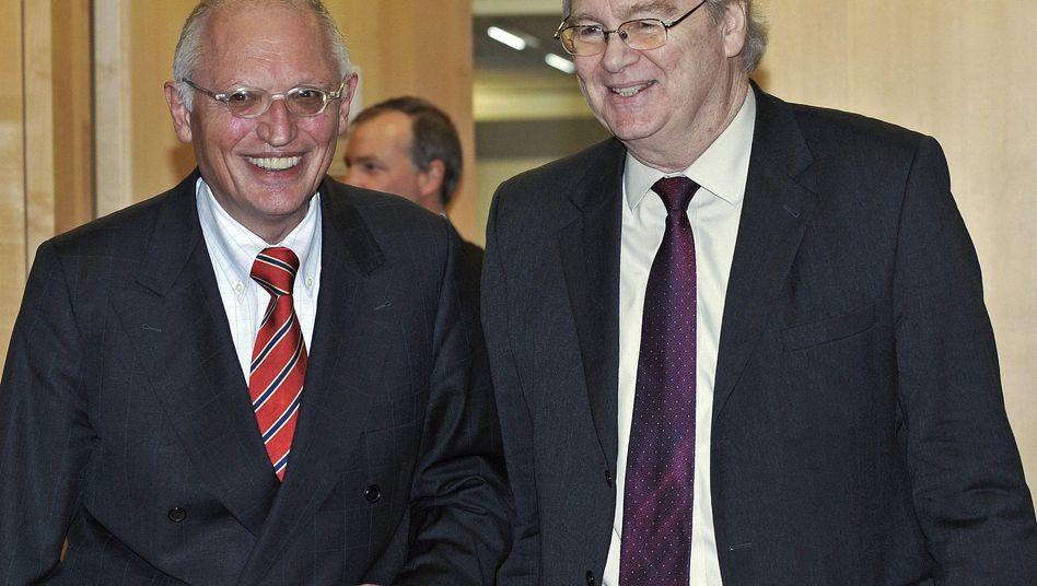 EU-Industriekommissar Verheugen (l.) und GM-Europachef Reilly: gemeinsam abstimmen