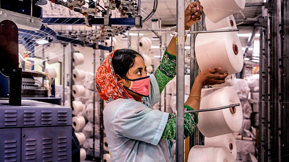 A textile worker in Tongi, Bangladesh: Orders worth billions were cancelled.