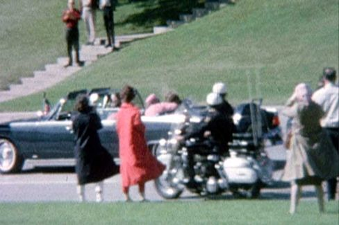 First Lady Jacqueline Kennedy cradles her husband President John F. Kennedy seconds after he was fatally shot in Dallas.