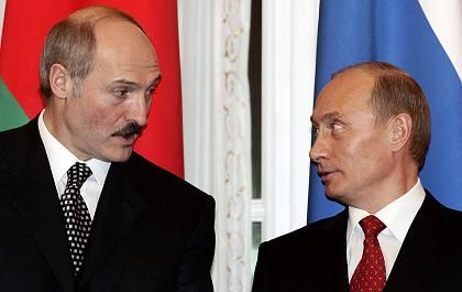 Belarus has imposed a new tax on Russian oil in the latest move in an energy dispute between the two countries. In this January 2006 file photo, Belarus President Alexander Lukashenko speaks with his Russian counterpart Vladimir Putin in St. Petersburg.