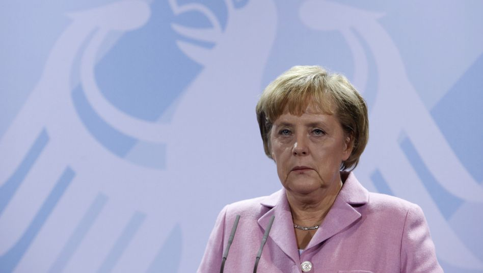 It's been a difficult few weeks for Chancellor Angela Merkel, shown here at a news conference last week.