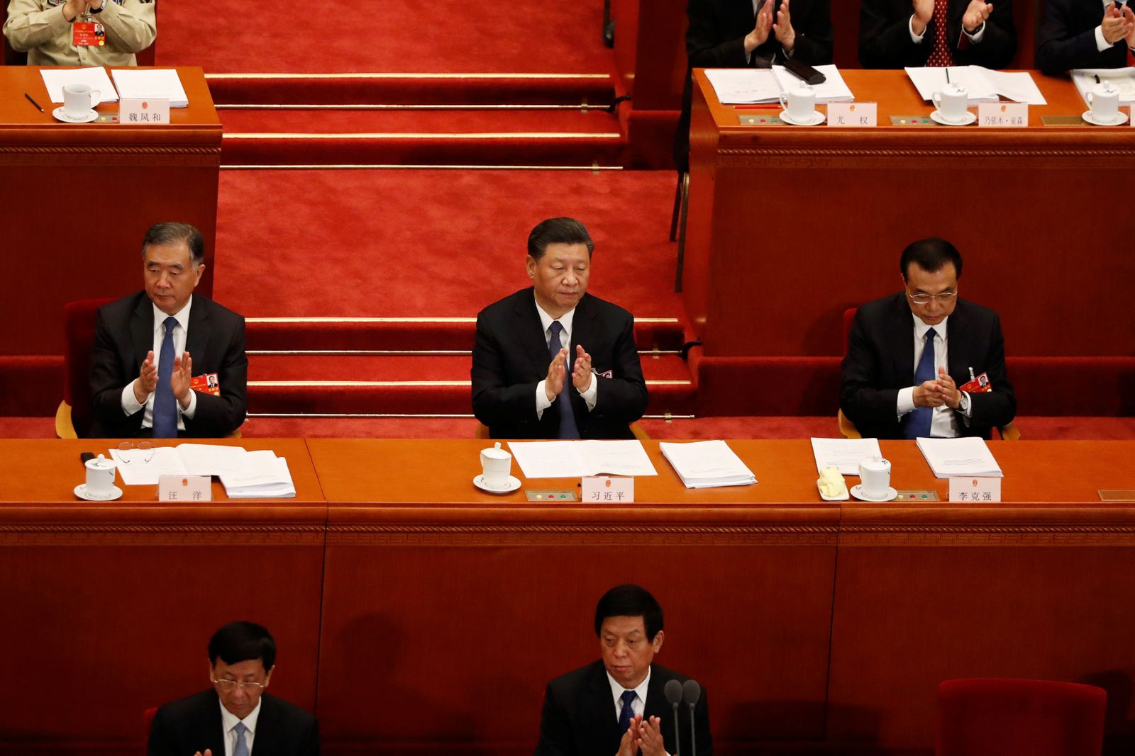 Chinese President Xi Jinping and other officials attend the opening session of NPC in Beijing