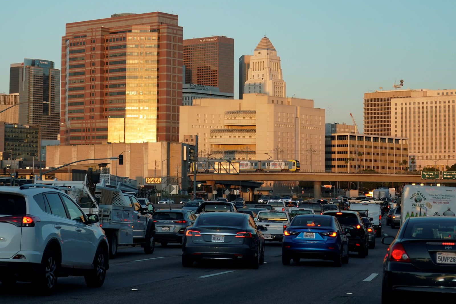Traffic travels along a highway next to Los Angeles, California