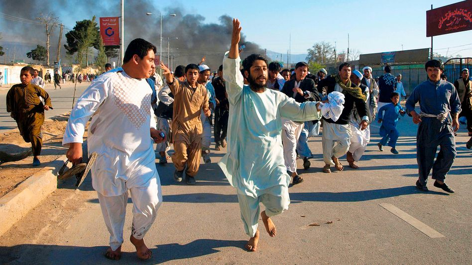 """Afghan protesters at an April 1 demonstration to condemn the burning of the Koran by an American pastor: """"""""Use every weapon, the word or the club to defend the Koran."""""""