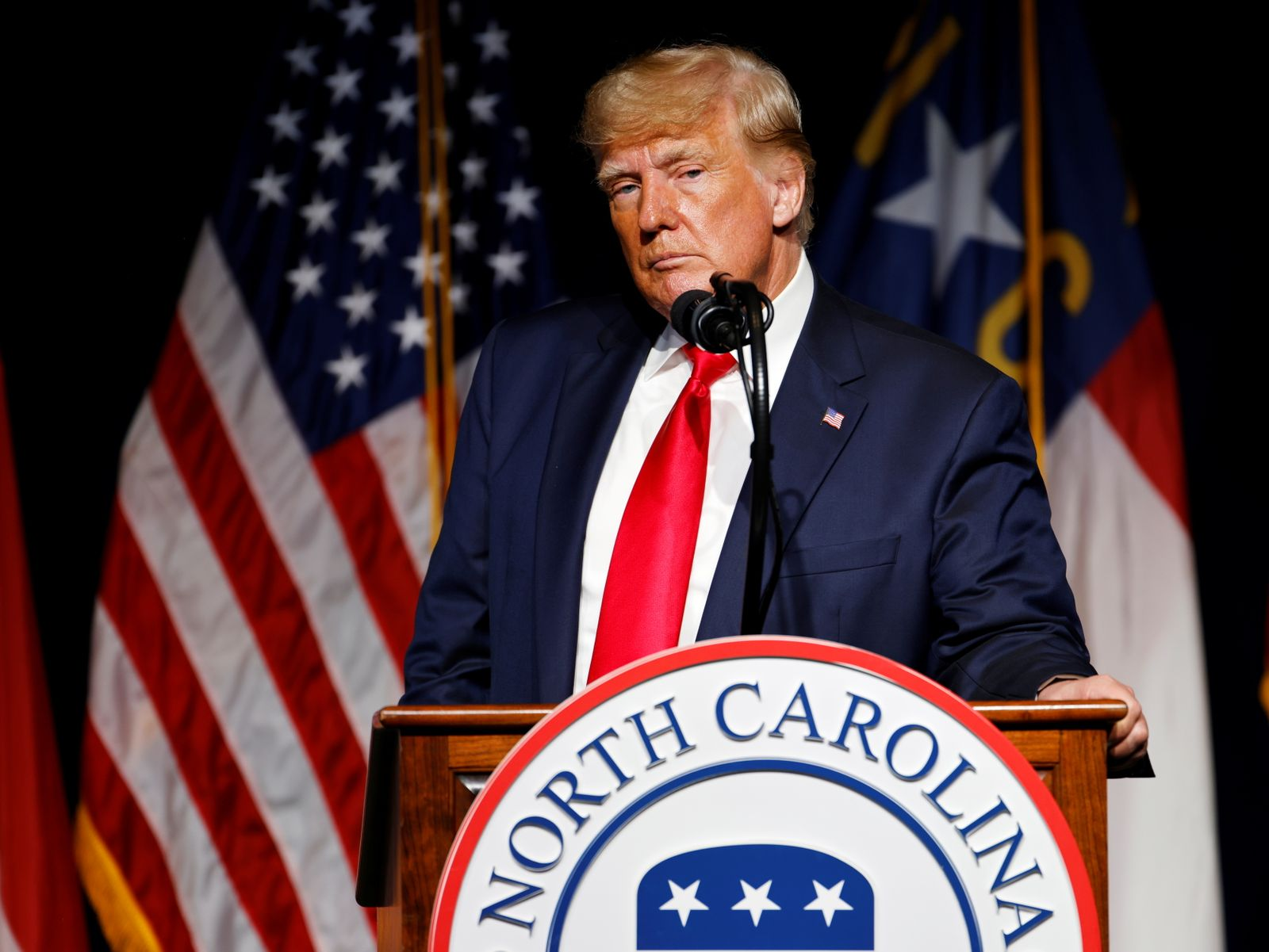 Former U.S. President Donald Trump pauses while speaking at the North Carolina GOP convention dinner in Greenville