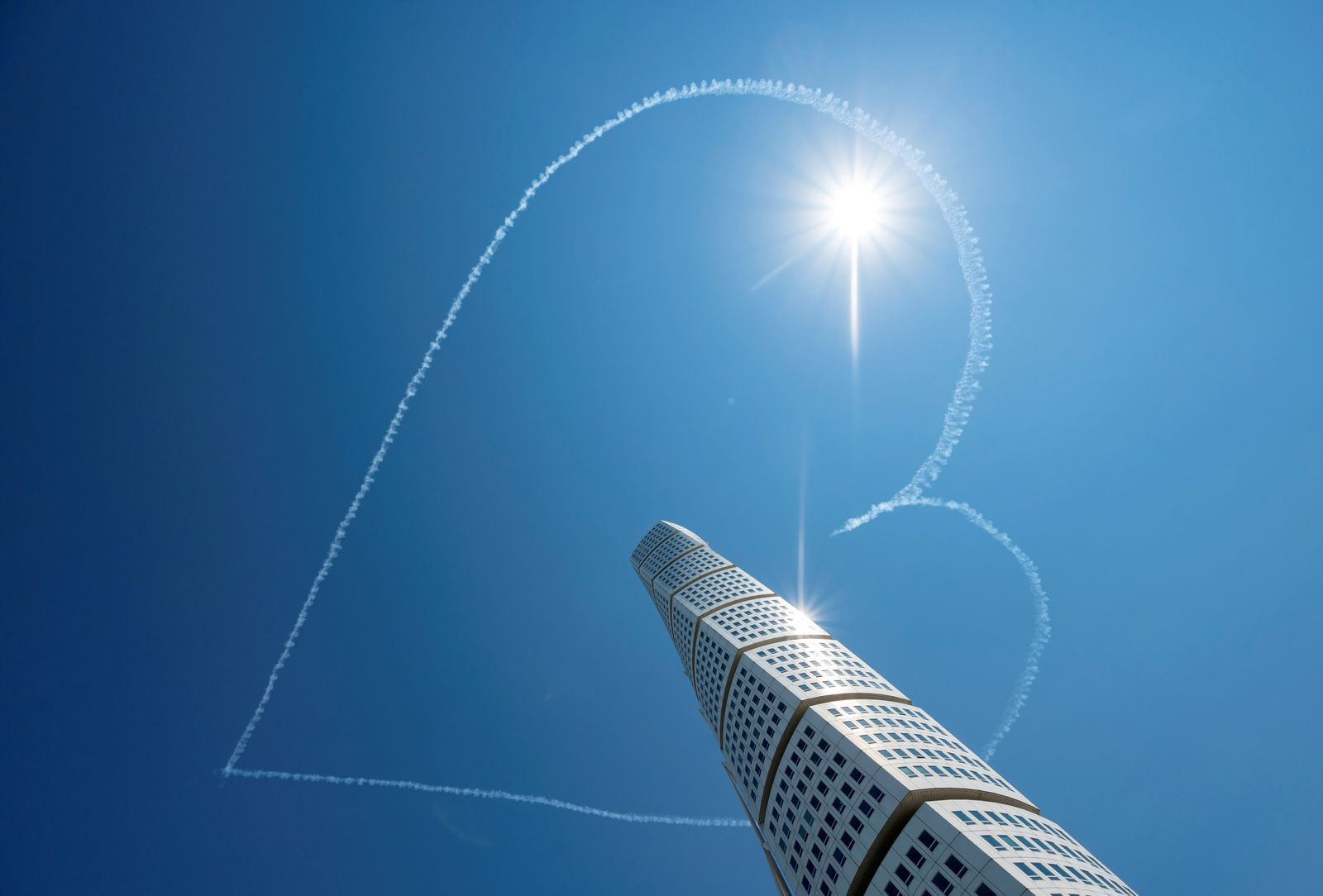 Airplanes of the Scandinavian Airshow draw a heart in the sky, above the Turning Torso building, amid the spread of the coronavirus disease (COVID-19), in Malmo