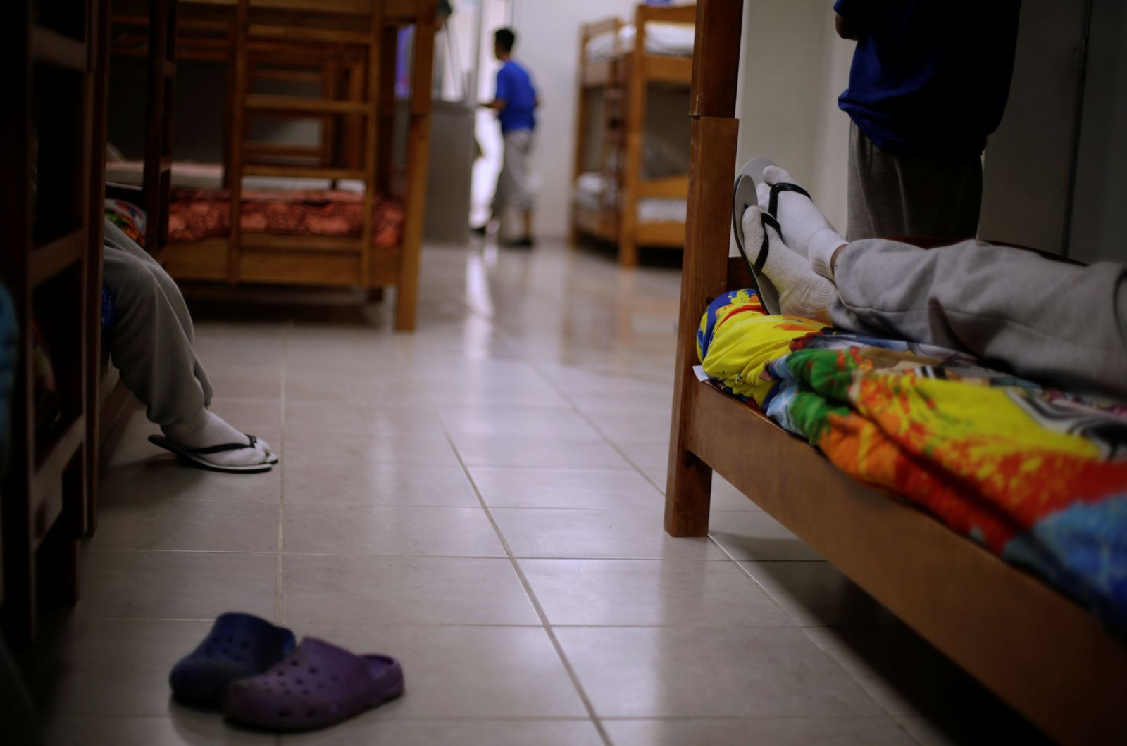 Migrant children from Central America and Mexico rest in a dormitory at the Noemi Alvarez Quillay immigrant shelter for unaccompanied minors, run by the Mexican government, in Ciudad Juarez
