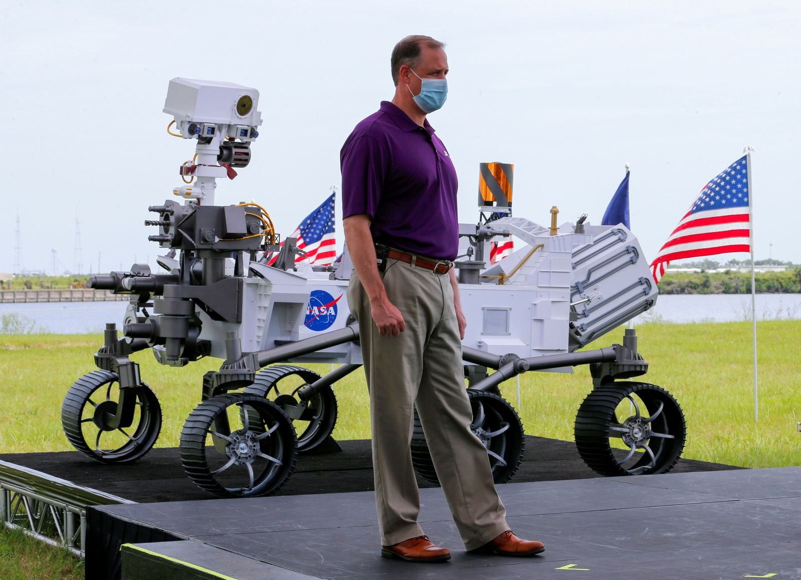 FILE PHOTO: NASA Administrator Jim Bridenstine stands next to a replica of the Mars 2020 Perseverance Rover during a press conference, at the Kennedy Space Center in Cape Canaveral