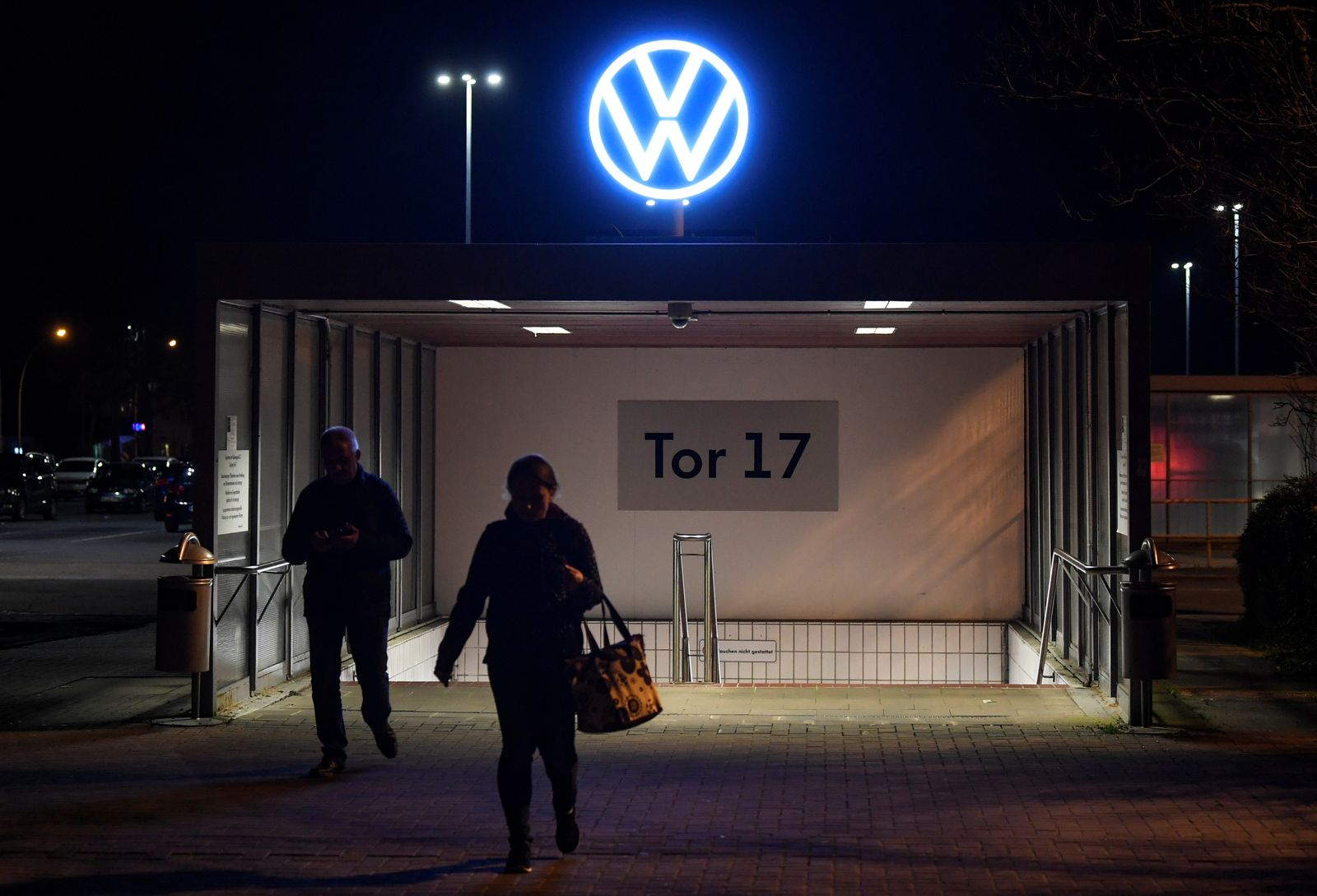Employees leave the Volkswagen plant after VW starts shutting down production in Europe amid the outbreak of coronavirus disease (COVID-19) in Wolfsburg