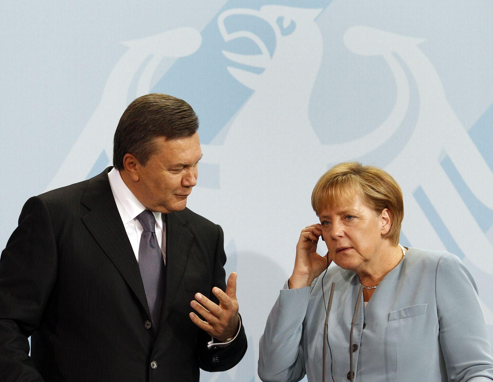 Merkel/ Janukowitsch