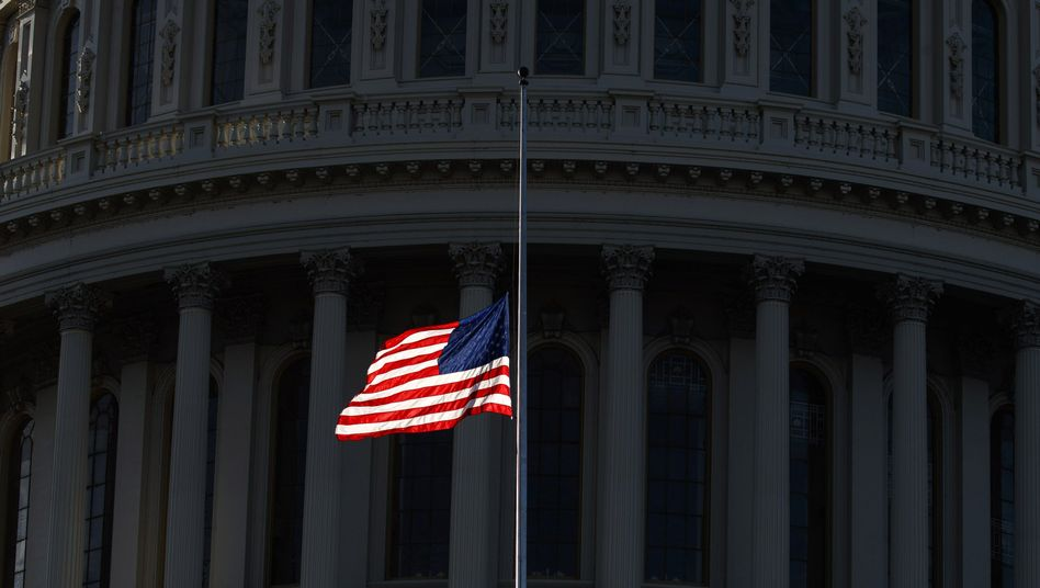The U.S. flag in front of the Capitol Building: It's time for America to show that it's capable of defending its democracy.