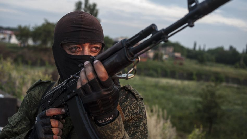 A pro-Russian fighter in Ukraine. Two teams of OSCE observers have been held hostage in eastern Ukraine for weeks.