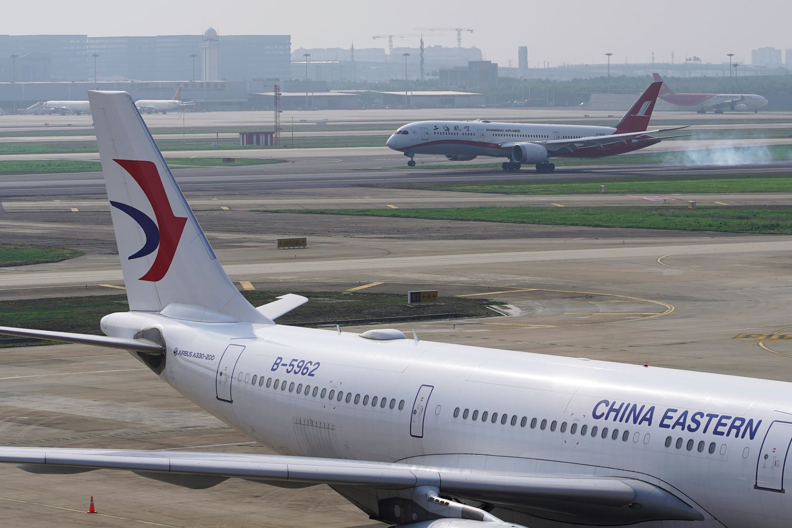 A China Eastern Airlines aircraft and a Shanghai Airlines aircraft are seen in Hongqiao International Airport in Shanghai