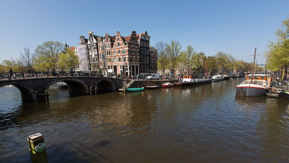 A canal view in Amsterdam: Weak economic prospects led the Netherlands to lose its top rating on Friday.