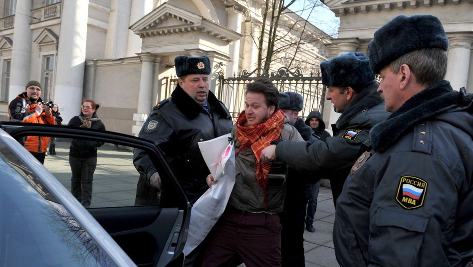Police detain a gay rights activist in St. Petersburg on Thursday.