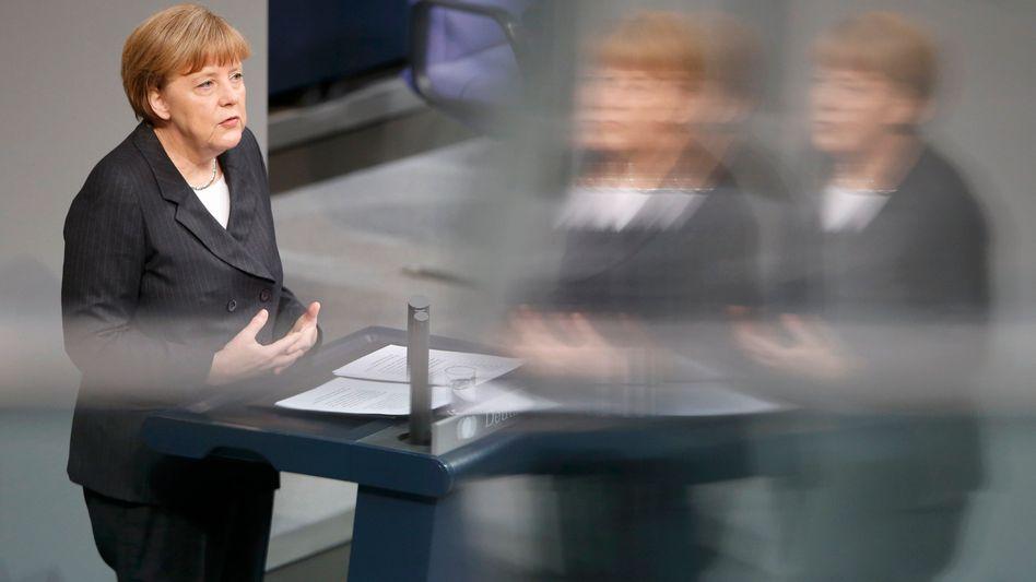 Regierungserklärung: Merkel nimmt Muslime in Schutz