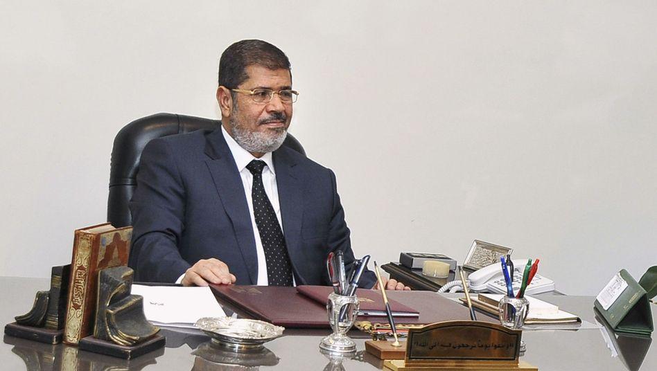 """Ägyptens Staatschef Mohammed Mursi (am 5. Dezember): """"Ist das nicht Demokratie?"""""""