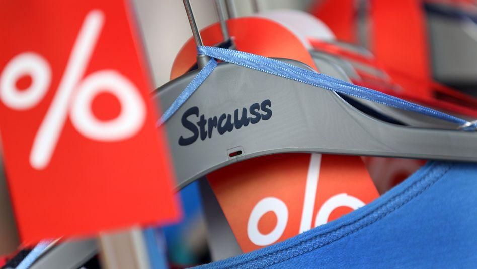 Strauss-Filiale in Düsseldorf: Rückzug unter den Schutzschirm
