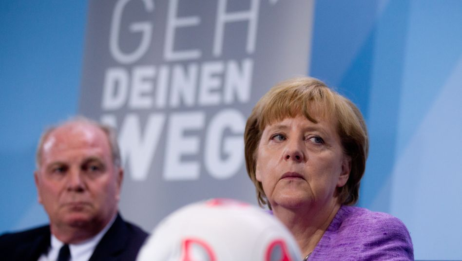 Uli Hoeness and Angela Merkel attend the launch of campaign to promote the integration of immigrants last year.