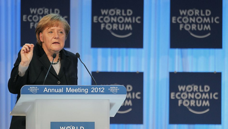 Merkel delivers the opening address at the World Economic Forum on Jan. 25.