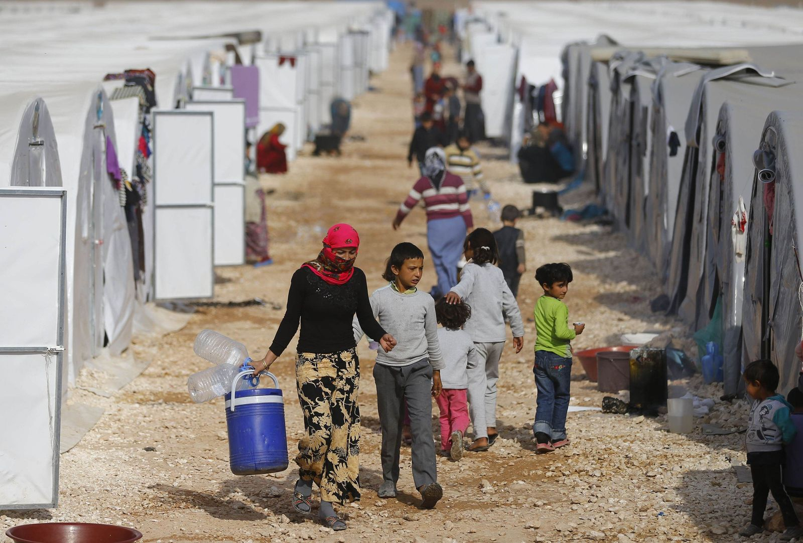 Kurdish refugees from Kobani are seen in a camp in Suruc