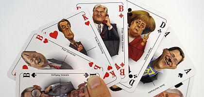 Caricatures of German politicians, on a deck of cards. Are they gambling that the electorate will believe their election promises?