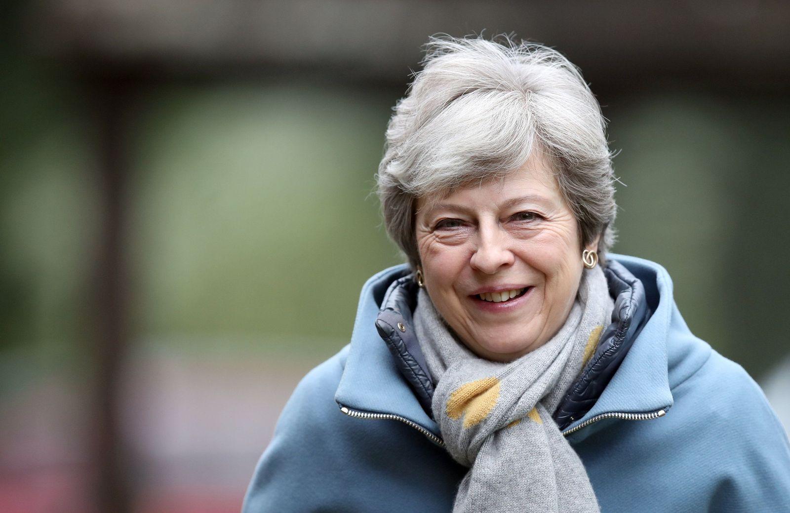 Theresa May attends church