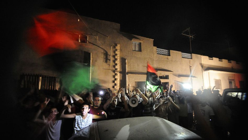 Supporters of Libyan rebels celebrate in Tripoli on Monday evening.