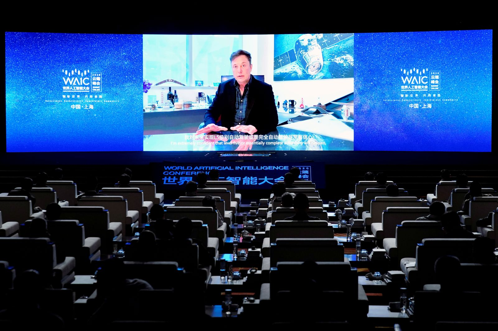 Tesla Inc CEO Elon Musk is seen on a screen during the opening ceremony of the WAIC in Shanghai