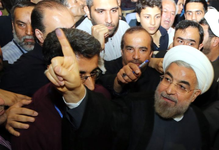 Iranian President Hassan Rouhani (right): Relations with Saudi Arabia have worsened despite pledges to improve them.