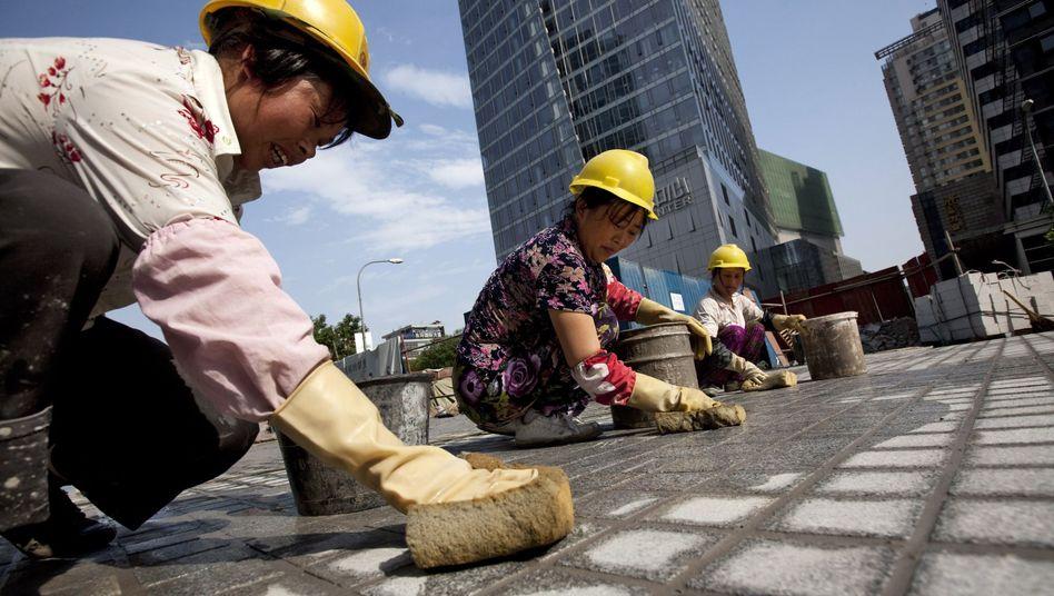 Baustelle in Peking: China dürften die billigen Arbeitskräfte ausgehen