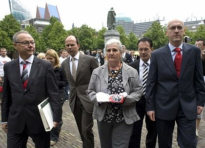 "Dutch lawyers Axel Hagedorn and Marco Gerritsen, a ""Mother of Srebrenica"" Maunira Subasic, and lawyers Faruli Capina and Semir Guzin on their way to deliver a civil summons at the Dutch Supreme Court in the Hague, the Netherlands on Monday."