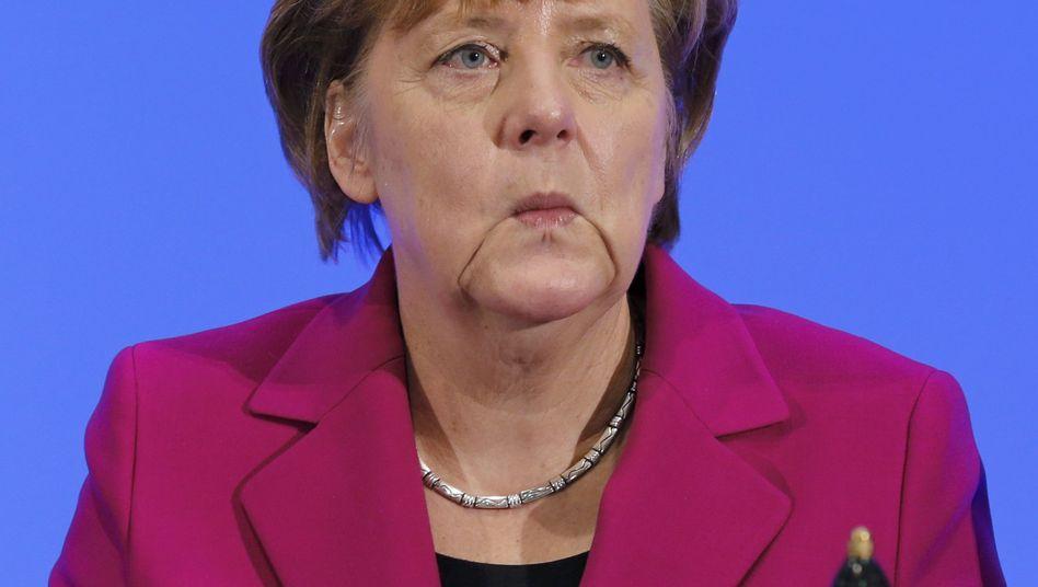 Merkel muss Interview unterbrechen