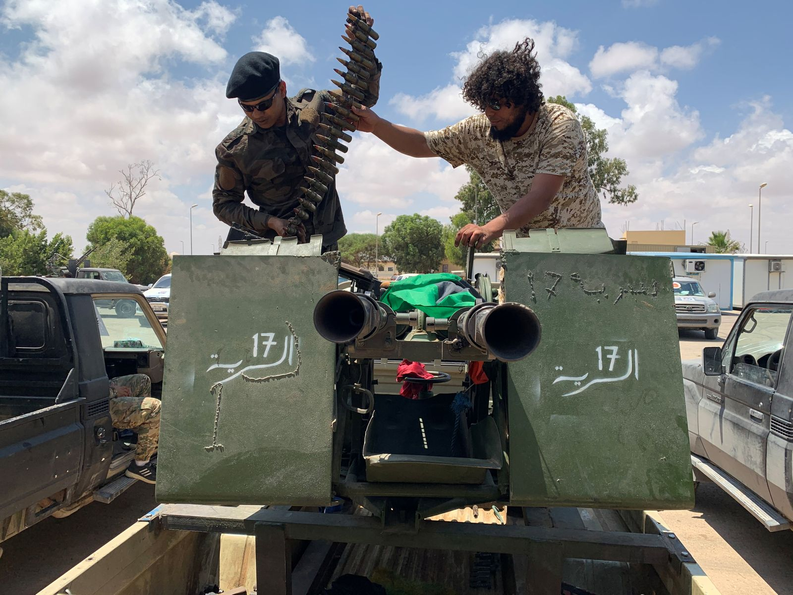 Troops loyal to Libya's internationally recognized government prepare themselves before heading to Sirte, in Tripoli