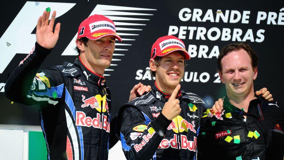 Red-Bull-Teammitglieder Webber, Vettel, Horner (v.l.n.r.): Zweiter Titel in Abu Dhabi?